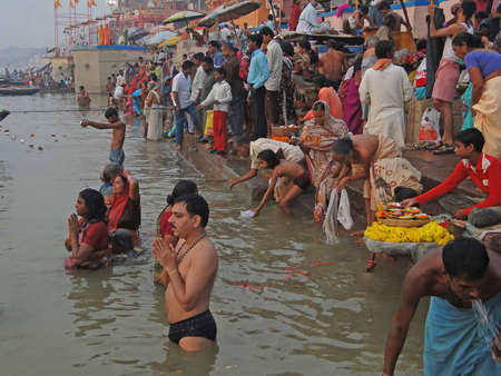 VARANASI, INDIA - NOV 6 -  Hindus perform ritual puja at dawn in the Ganges River  on Nov 6, 2009,  in Varanasi, India.