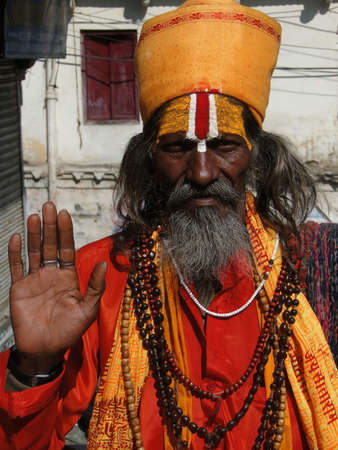 hindu temple: UDAIPUR, INDIA - DEC 2 - Hindu Sadhu gives blessings outside a temple on Dec 2, 2009 in Udaipur, India