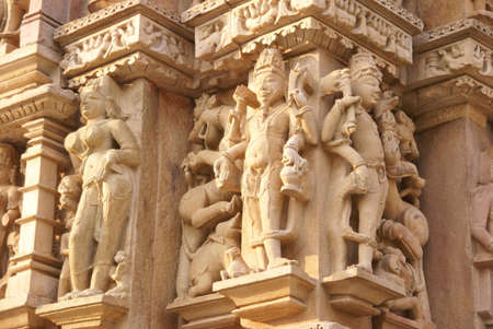 Sculptures of loving couples, mythical figures on outer walls of  Parsavanatha, Jain Temple Khajuraho,  India photo