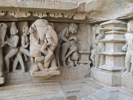 Sculptures of loving couples, illustrating the Kama Sutra, on walls of  Varaha Temple, Khajuraho in  India, Asia photo