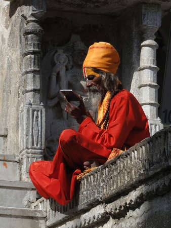 sadhu: UDAIPUR, INDIA - DEC 2 - Hindu Sadhu gives blessings outside a temple on Dec 2, 2009 in Udaipur, India