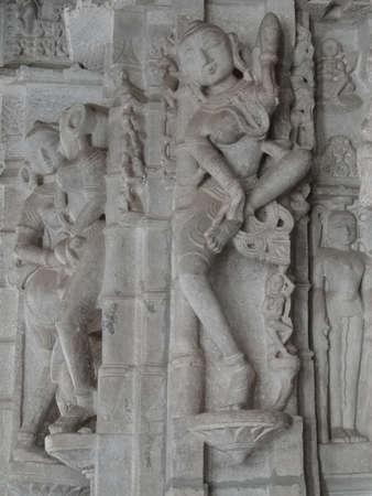 apsara: Beautiful apsara dancing girl carved on temple pillar,  Jain temple, Ranakapur, India