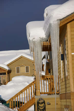 townhouses: Large icicles on  Townhouses after heavy snowstorm, Steamboat Springs, Colorado, Rocky Mountains  Stock Photo