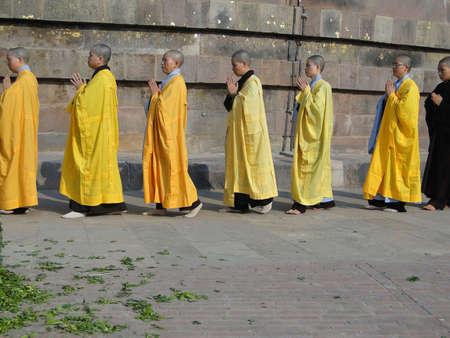 SARNATH INDIA - 6 NOV 2009 - Japanese monks and nuns perform Buddhist rituals at Dharmeka Stupa at Sarnath,  India, on 6 Nov 2009.