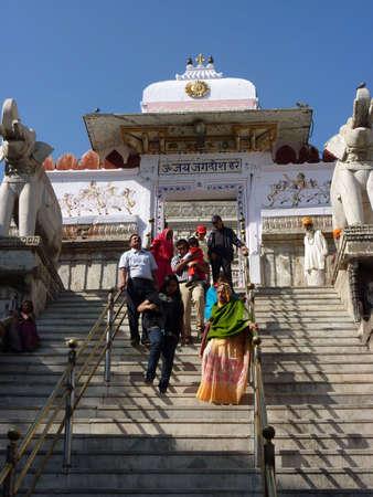 UDAIPUR, INDIA - DEC 2 -Indian pilgrims descend temple stairs on Dec 2, 2009 in Udaipur, India