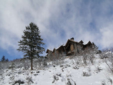 Winter snow on large modern homes in Cordillera,Colorado..