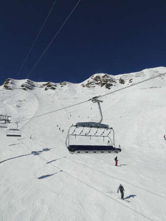 Ski lift and skiers  in alpine snow Portes du Soleil, Switzerland