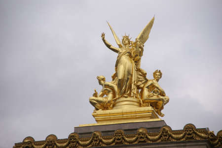 Winged golden statues atop the Paris Opera House Paris, France