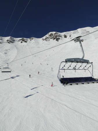 soleil: Ski lift and skiers  in alpine snow Portes du Soleil, Switzerland