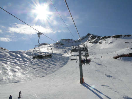 soleil: Ski lift and skiers  in alpine snow Portes du Soleil, Avoriaz, France