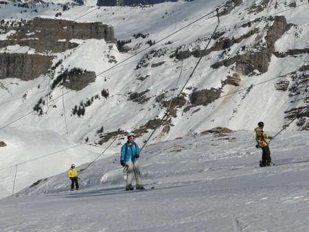 dragline: AVORIAZ, FRANCE - FEB 25 - Skiers use the dragline to ascend the slopes  on Feb 25, 2012 in Avoriaz, France