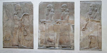 babylonian: Ahura mazda, zoroastrian god, and worshippers, bas relief from Persia, Louvre Museum, Paris , France