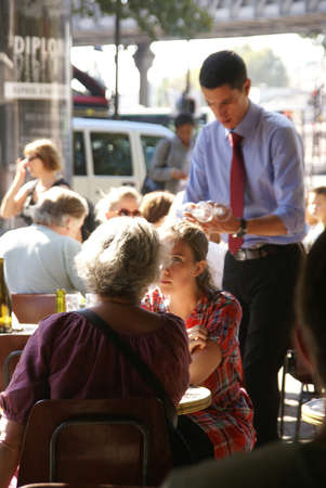 PARIS - OCT 3 - Parisians and tourists spend happy hour in a café   on Oct 3, 2011, in Paris, France.