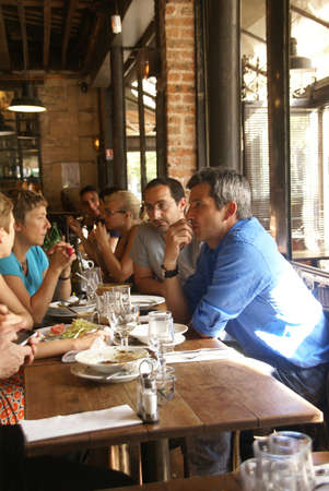 PARIS - OCT 3 - Parisians and tourists spend happy hour in a cafe, on Oct 3, 2011, in Paris, France