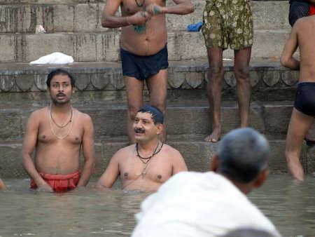 VARANASI, INDIA - NOV 6 -  Hindus perform ritual puja at dawn in the Ganges River  on Nov 6, 2009,  in Varanasi, India.                 Stock Photo - 13386546