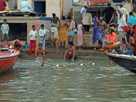 VARANASI, INDIA - NOV 6 -  Hindus perform ritual puja at dawn in the Ganges River  on Nov 6, 2009,  in Varanasi, India.                      Stock Photo - 13386567