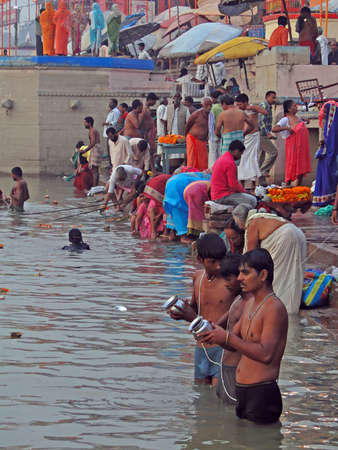 benares: VARANASI, INDIA - NOV 6 -  Hindus perform ritual puja at dawn in the Ganges River  on Nov 6, 2009,  in Varanasi, India.