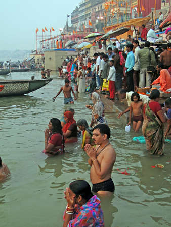 ghat: VARANASI, INDIA - NOV 6 -  Hindus perform ritual puja at dawn in the Ganges River  on Nov 6, 2009,  in Varanasi, India. Editorial