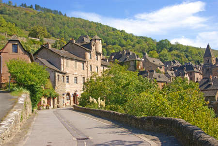 Approaching the medieval hill town  of Conques, France
