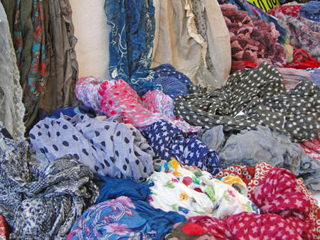 Colorful scarfs and kerchiefs  at the weekly market,  on Sep 27, 2011 in Vaison la Romaine, France.