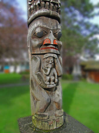 haida indian: Totem pole carved from cedar, Thunderbird Park, Victoria, BC, Canada  Editorial