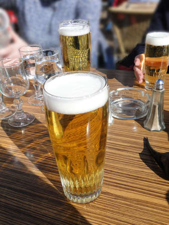 water skiers: Glasses of beer and water  for skiers on a sunny day, Portes du Soleil, Avoriaz, France