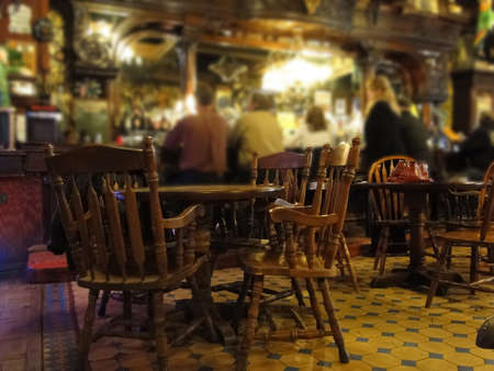bar: Patrons sit at the old western bar in a tavern in Leadville, CO