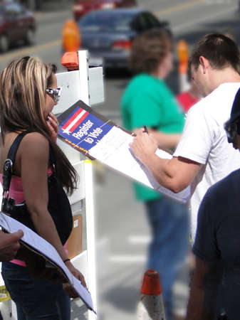SEATTLE - MAY 15 -  Young woman registers new voters  at the U District Street Fair on May 15, 2010, in Seattle