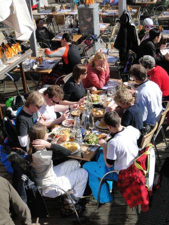 AVORIAZ, FRANCE - FEB 25 - Skiers enjoy lunch outdoors in the sun  on Feb 25, 2012 in Avoriaz, France