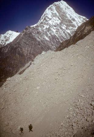 Trekkers and Sherpas near Teschi Lapcha pass at 19,000 Stock Photo
