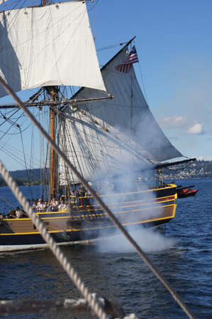broadside: KIRKLAND, WASHINGTON - AUG 31 - The wooden brig, Lady Washington, fires her cannon   during a mock sea battle as part of Labor Day festivities on Aug 31, 2012 near Kirkland , Washington.   Editorial