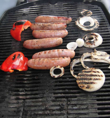 Grilled sausages, onion and peppers, ready to eat, summer in Seattle