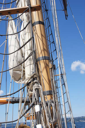 Mast, yardarms, rigging and sails of tall ship  near Kirkland, Washington