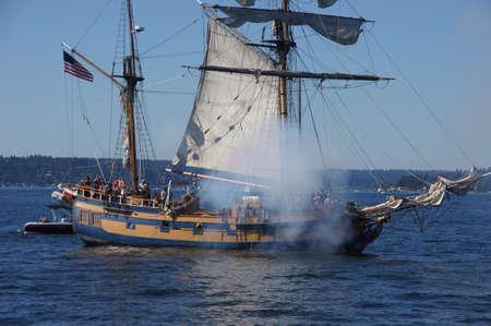 chieftain: KIRKLAND, WASHINGTON - SEP 1 - The ketch, Hawaiian Chieftain, fires her cannon   during a mock sea battle as part of Labor Day festivities on Sep 1, 2012 near Kirkland , Washington.