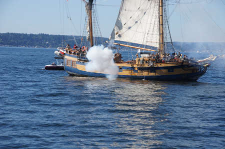 broadside: KIRKLAND, WASHINGTON - SEP 1 - The ketch, Hawaiian Chieftain, fires her cannon   during a mock sea battle as part of Labor Day festivities on Sep 1, 2012 near Kirkland , Washington.