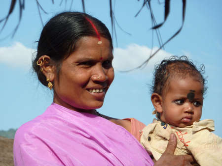 ORISSA,  INDIA - NOV 10  -Tribal mother and her child pose for portraits  on  Nov 10, 2009 in Orissa, India.