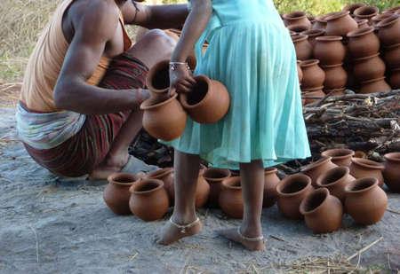 kiln: ORISSA,  INDIA - Nov 13 -Potter builds an outdoor kiln for clay pots on Nov 13, 2009, in Orissa, India