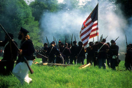 civil war: SEATTLE - JUL 10 - Union infantry line fires on advancing  Confederate soldiers, during a Civil War battle reenactment on July 10, 1996 near Seattle.