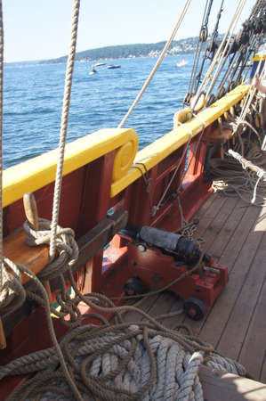 broadside: Small naval cannon on board  historical wooden brig