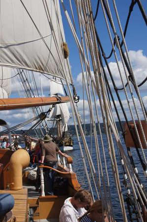ketch: KIRKLAND, WASHINGTON - AUG 31 - The crew rigs the sails of the Hawaiian Chieftain as she sails on Lake Washington    during a mock sea battle as part of Labor Day festivities on Aug 31, 2012 near Kirkland , Washington.   Editorial