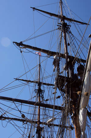 ketch: Sailor climbs the rigging  on the mast of a tall ship