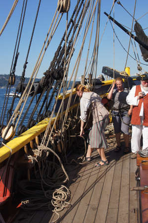 ketch: KIRKLAND, WASHINGTON - SEP 1 - The crew sets the sails of the Lady Washington as she sails on Lake Washington    during a mock sea battle as part of Labor Day festivities on Sep 1, 2012 near Kirkland , Washington.   Editorial
