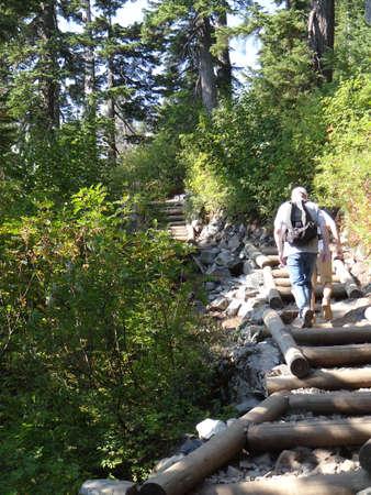 Hikers climbing wooden steps on steep mountain trail near Snoqualmie Pass, Washington   Sajtókép