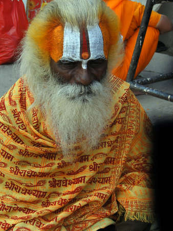 VARANASI INDIA - 6 NOV 2009 -  Hindu Sadhu gives blessings on the bathing ghats of Varanasi on 6 Nov 2009   Editorial