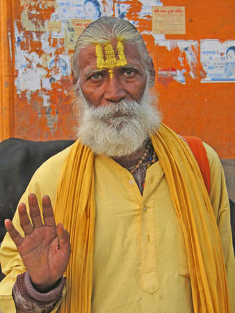 sadhu: VARANASI, INDIA - NOV 6 -  Hindu Sadhu gives blessings on the bathing ghats on Nov 6, 2009,  in Varanasi, India.