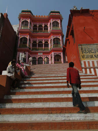 dhobi ghat: VARANASI, INDIA - NOV 7 - Hindu pilgrims climb the steps of a Shiva temple  on the Gabges bank on Nov 7, 2009, in Varanasi, India.