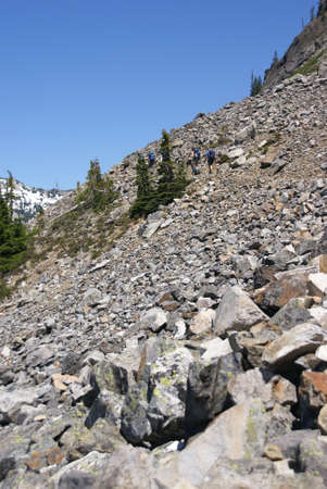 Hikers on steep rocky trail  near Red Mountain  in the North Cascades, Washington