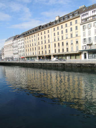 GENEVA, SWITZERLAND - Feb 10 -  Large hotels form reflections in the Rhone River  on Feb 10, 2010,  in Geneva, Switzerland.