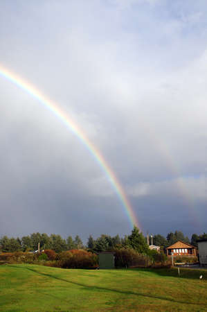 showers: Double rainbow over a field during autumn showers in Ocean Shores, Washington
