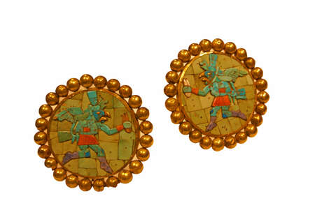 3rd century: Hammered gold earflares with turquoise and shell inlay,  3rd - 7th century Moche culturePeru